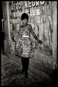 DEPARA (DRCongo) fem001-Woman in front of Afro-Negro Club (Serie : In the dancings-bars of Kinshasa, DRCongo, ca. 1965) Fine art modern print (2010 Print)from original negative 6 x 6 cm (ca. 1965)on silver barium paperunder control of Revue Noirein limited edition of 5 copiesNot framedExtra shipping by express carrierCertified original by Revue NoireSigned by the Estate of DeparaPaper format about 40 x 30 cm (print about 27 x 27 cm)