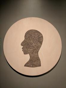 """Kathryn Wabegijib """"Self Portrait in Reclaimed Cooper"""""""