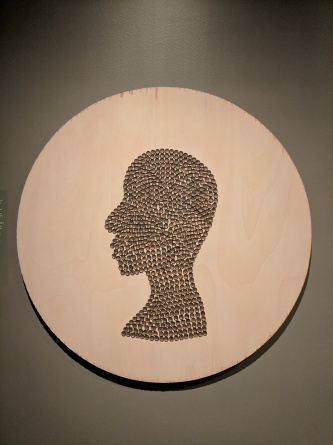"Kathryn Wabegijib ""Self Portrait in Reclaimed Cooper"""