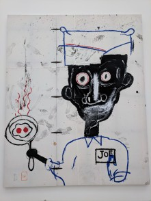 """Jean-Michel Basquiat """"Eyes and Eggs"""" 1983. Acrylic, oilstick, and paper collage on cotton drop cloth with metal hinges. Photo by Erin K. Hylton 2018."""